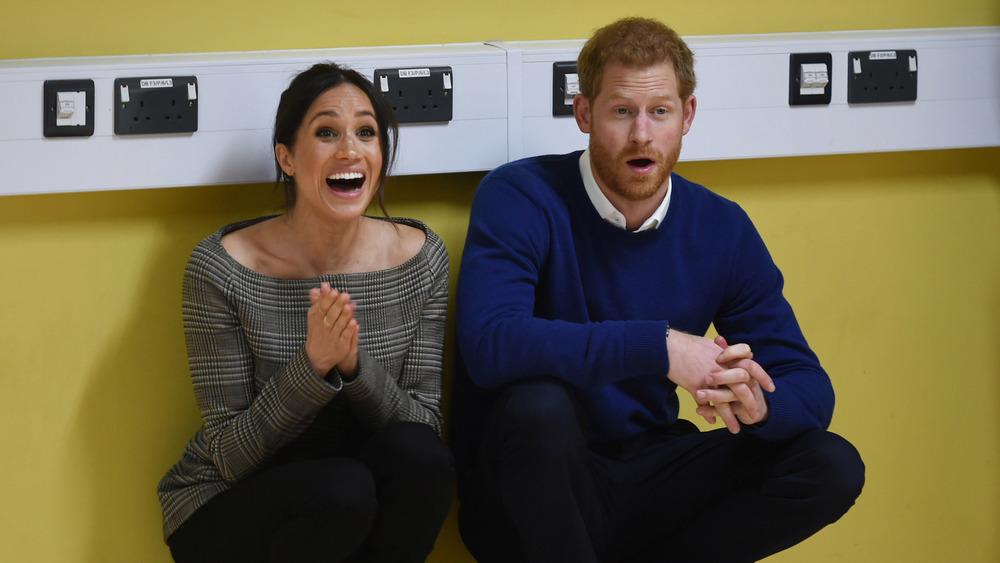 Prins Harry og Meghan Markle ler