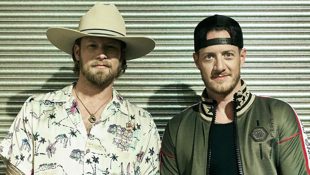 Brian Kelley og Tyler Hubbard smiler