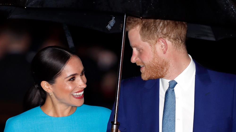Prins Harry og Megan Markle smiler