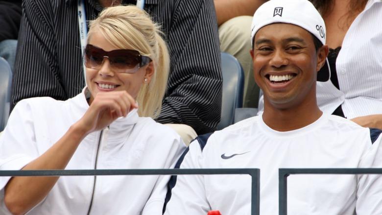 Elin Nordegren og Tiger Woods smiler