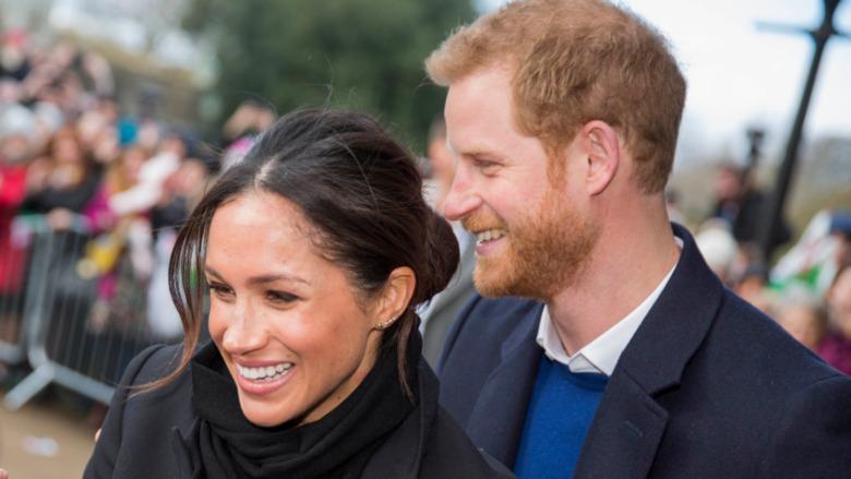 Meghan Markle og prins Harry smilte