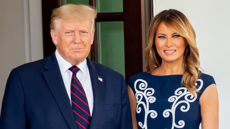 Donald og Melania Trump smilende