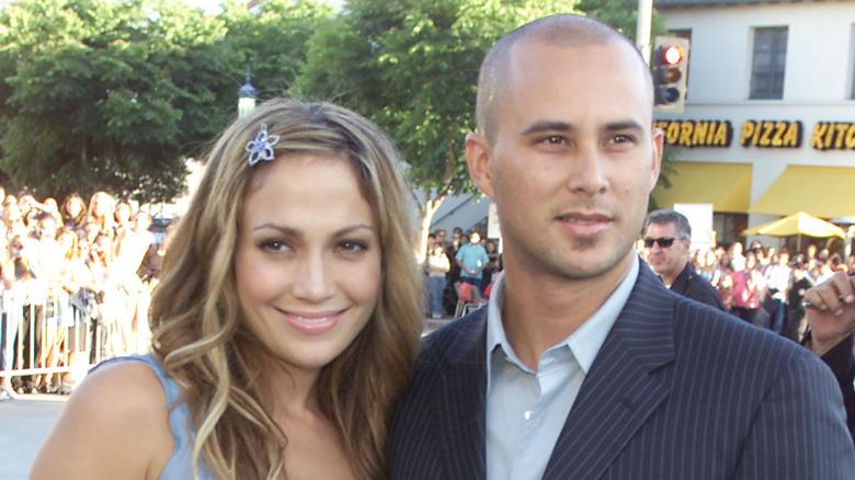 Jennifer Lopez og Cris Judd smiler