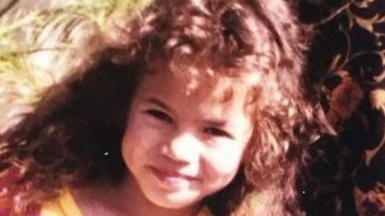 Barn Chrissy Teigen smilende