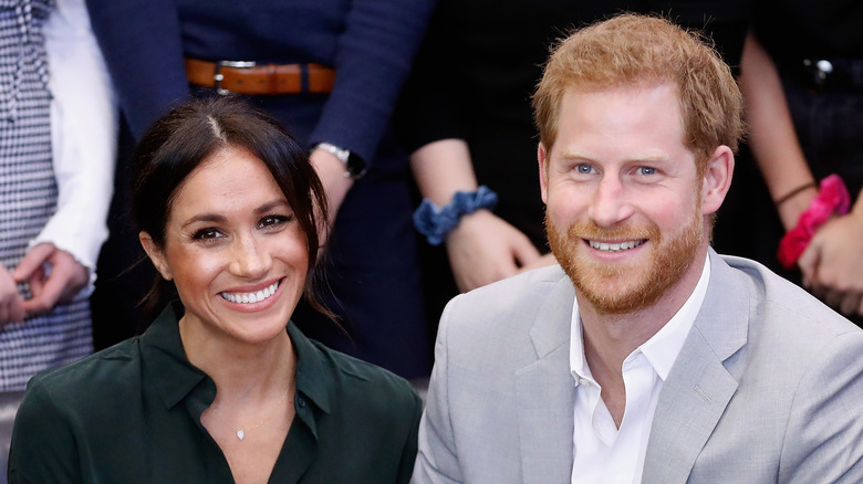 Meghan Markle og prins Harry smiler