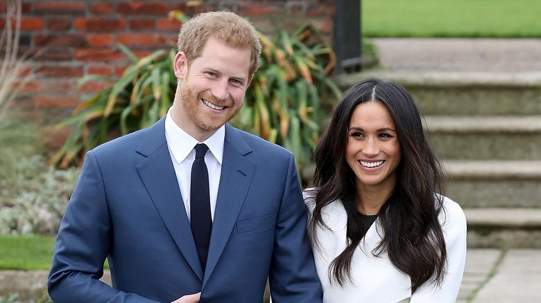 Prins Harry og Meghan Markle smiler