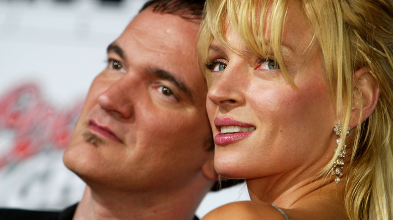 Quentin Tarantino og Uma Thurman poserer sammen