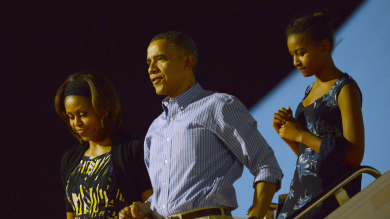 Michelle, Barack og Sasha Obama forlater Air Force One