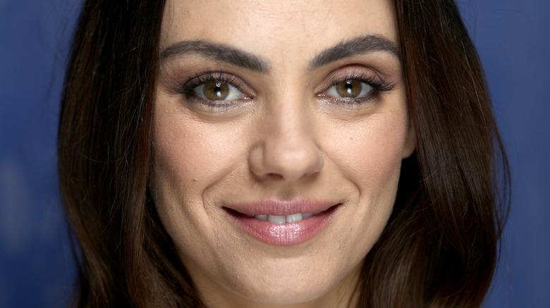 Mila Kunis smiler