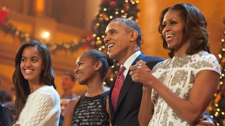 Obamas på en feriefest i Det hvite hus