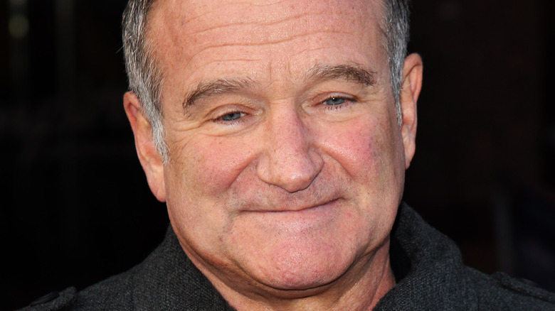 Robin Williams smilte i 2011.